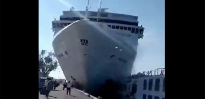 BREAKING: Tourists flee as cruise liner smashes into dock in Venice