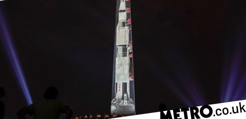 Apollo 11 anniversary celebrated with a 363-foot projection of Saturn V rocket