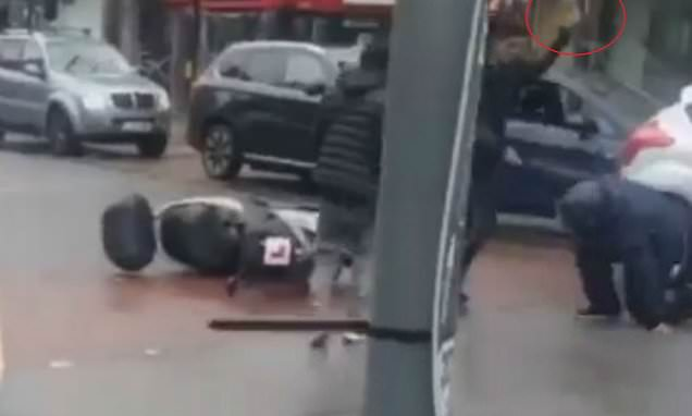 Shocking footage shows driver hitting a moped rider with a hammer