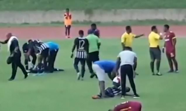 Football players collapse after bolt of lightning strikes pitch