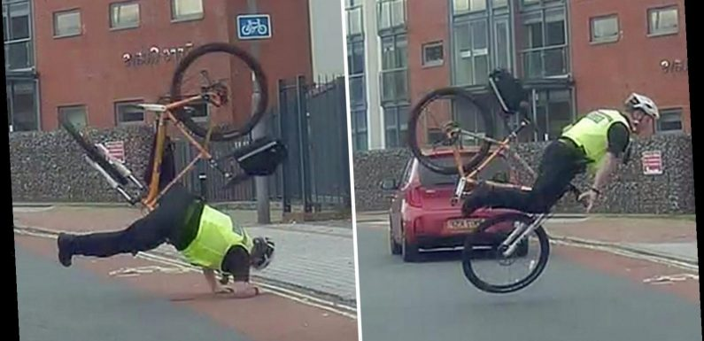 Moment bungling cop flips over bike's handlebars as he chases suspect