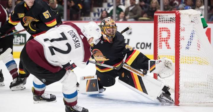 MacKinnon scores OT winner as Avs top Canucks