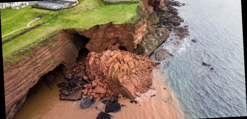 Huge cliff collapses into sea yards from homes sparking coastal warnings