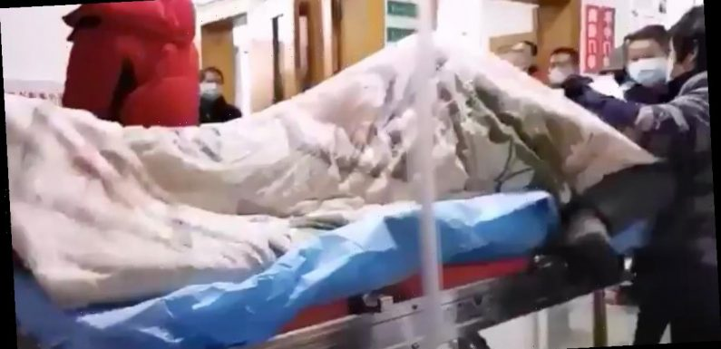 Coronavirus victim writhes around and shakes uncontrollably on hospital trolley