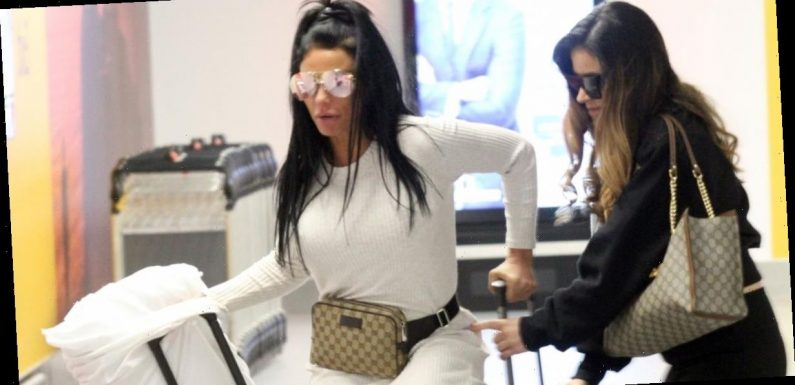Katie Price stumbles through airport and falls on suitcase ahead of masterclass