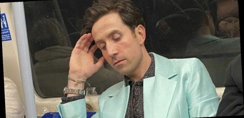 Nick Grimshaw travels to BRITs on London Underground in stunning turquoise suit
