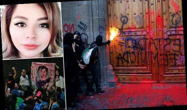 Female protesters fling red paint at Mexico's presidential palace