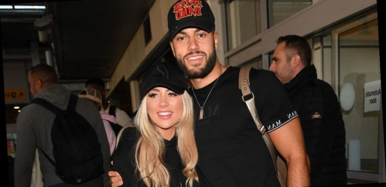 Love Island winners Paige and Finn share a passionate kiss as they arrive back in the UK from Cape Town