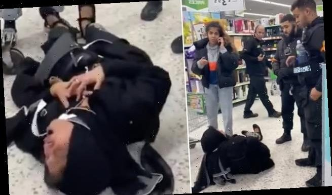 Asda shopper pretends to FAINT in front of bemused customers