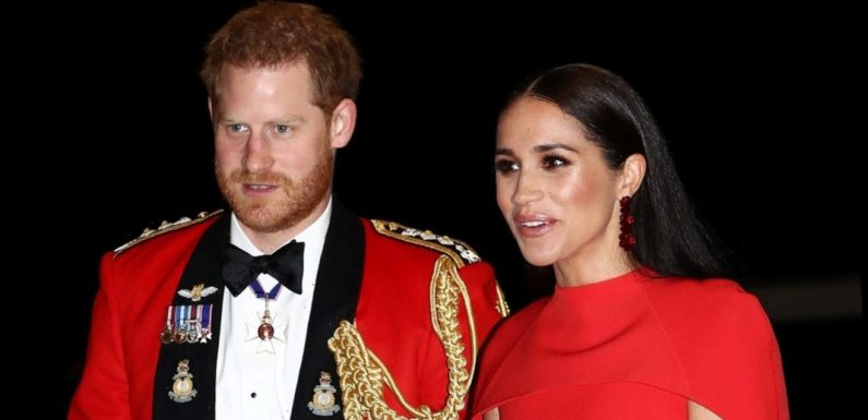 Meghan Markle and Prince Harry Were Just Spotted Holding Hands in Matching Red Ensembles
