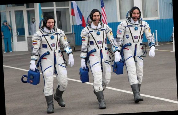 Astronauts leave virus-plagued planet for International Space Station