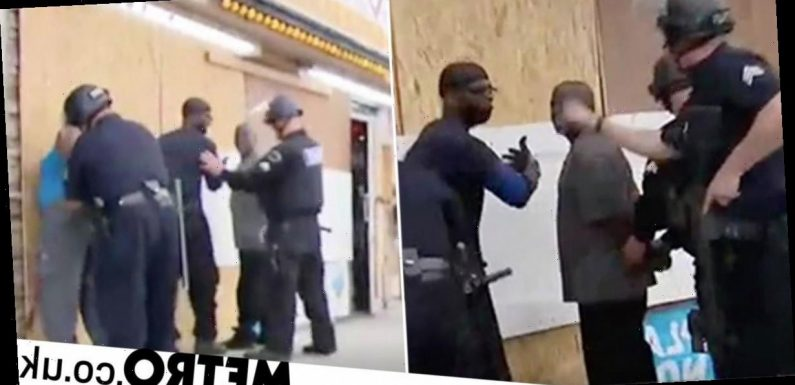 Police mistakenly cuff black Good Samaritans trying to protect shop from looters
