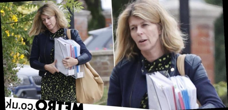 Kate Garraway heads home with piles of papers after heartbreaking news on Derek