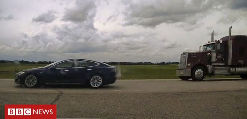 Tesla driver charged over 'napping while speeding'