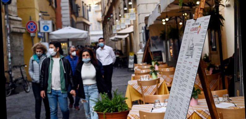 Italy tightens coronavirus lockdown rules after highest daily toll – with rule of six and 9pm curfew for public spaces