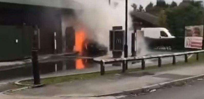 Car at McDonald's drive-thru bursts into flames as customer flees inferno