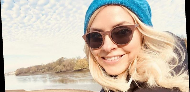 Holly Willoughby reveals her natural beauty as she 'tops up her Vitamin D' on a sunny walk by the river