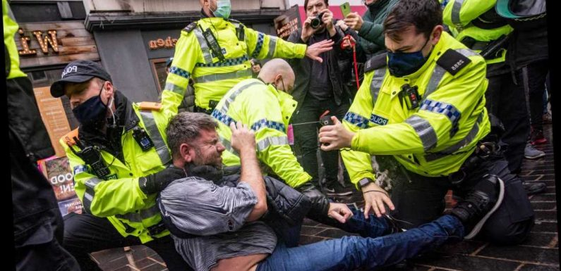 Anti-lockdown protesters clash with cops as hundreds chanting 'freedom' hit the streets