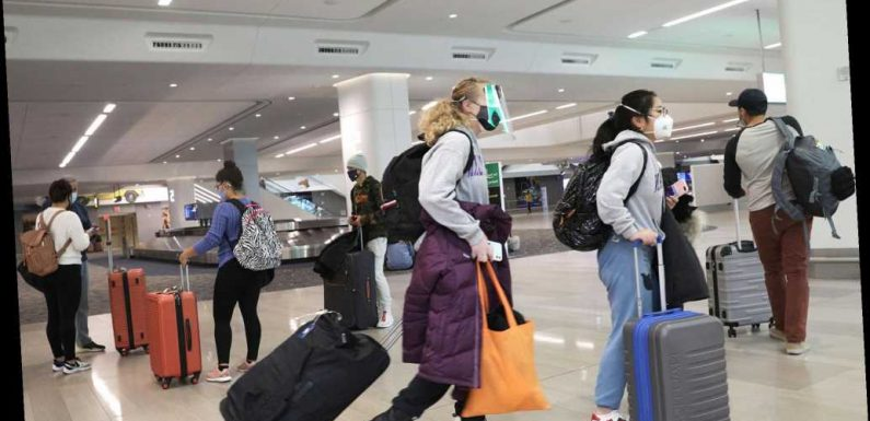 Travelers ignore guidance to stay home, pack airports for holiday travel