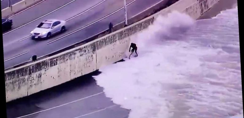 Wild video shows Chicago cyclist being wiped out by vicious Lake Michigan waves