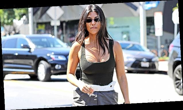 Kourtney Kardashian Stuns In High-Waisted Pants & Shimmery Bustier While Playing Dad's Old Records