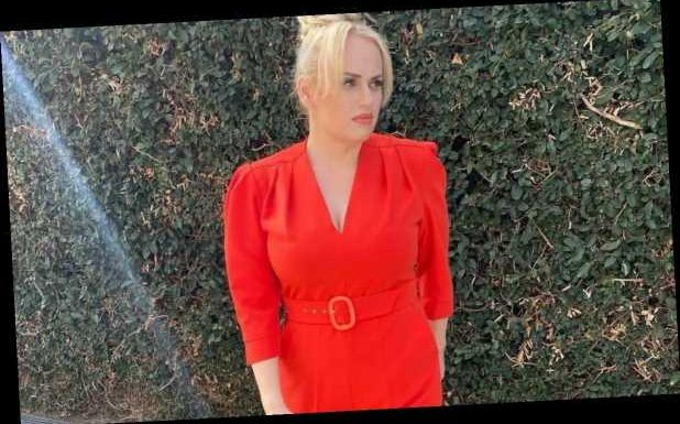 Rebel Wilson wows in a flatter-figuring red jumpsuit you need to see to believe