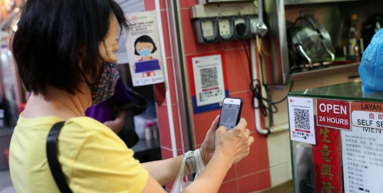 Nets to roll out new cashless payment features to help hawkers fight fraud