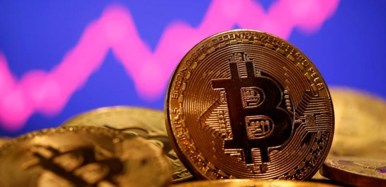 Bitcoin falls as much as 6% as it pulls back from record high