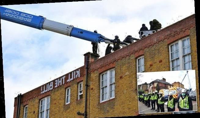 Bailiffs remove squatters from former police station roof in Clapham