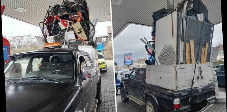 Cops stop learner driver at wheel of dangerously overloaded pickup truck with huge tower of furniture in the back