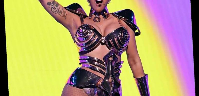 Cardi B Shows Major Skin in a Sexy Metal 'Gladiator' Bra During 2021 Grammys Performance