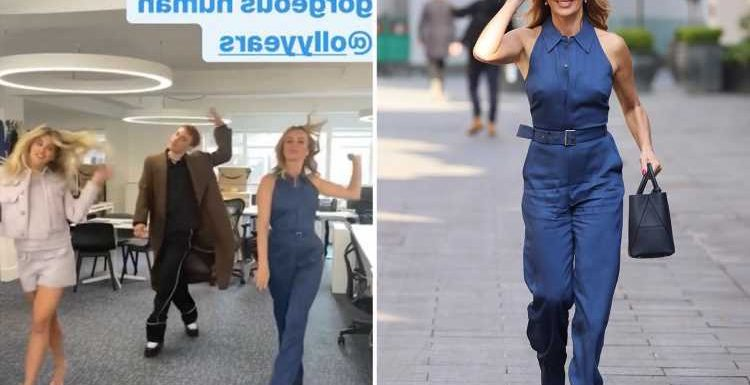 Amanda Holden struts about Heart Radio office in blue powersuit with It's A Sin star Olly Alexander