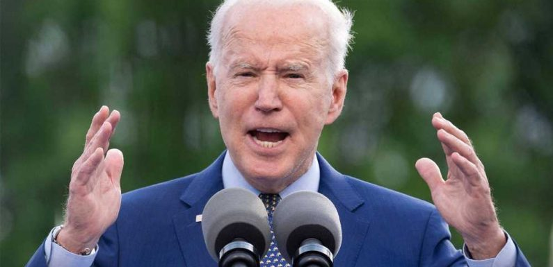 Biden heckled by 'Abolish ICE' protesters and teases possible immigration action