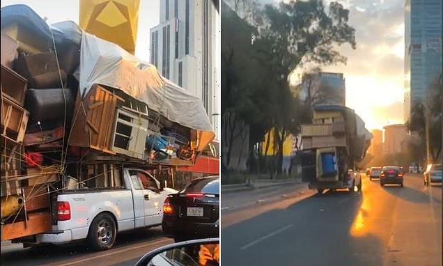 Driver in Mexico packs belongings on to slowly moving pickup truck