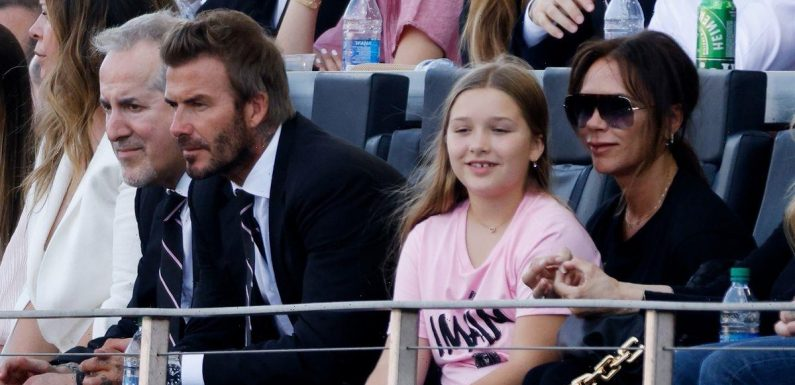 Harper Beckham shows her special bond with mum Victoria as she perches on her knee to watch dad David's team