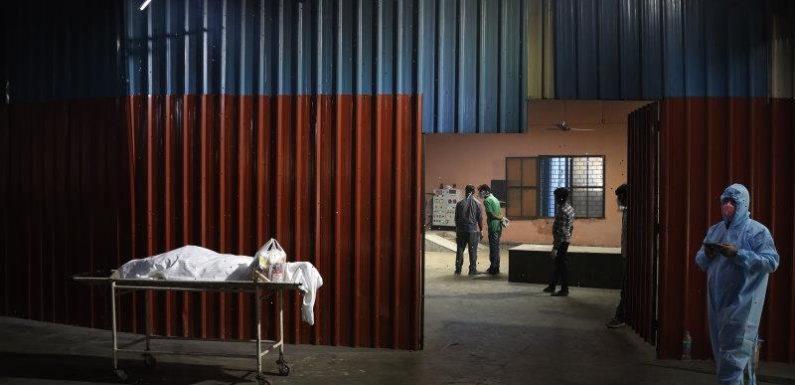 India's capital to lock down amid explosive coronavirus surge