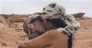 Kourtney Kardashian kisses boyfriend Travis Barker as she wears tiny thong in steamy snap