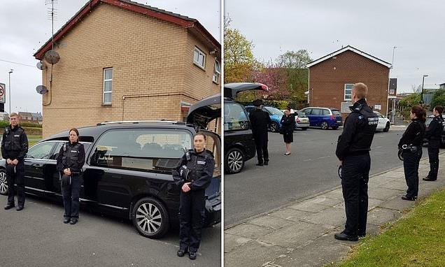 Police officers perform guard of honour at 101-year-old's funeral