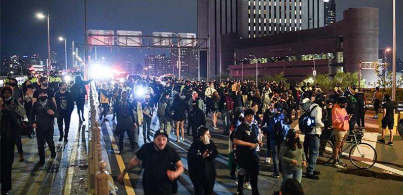 Protesters block traffic, clash with cops on Brooklyn Bridge
