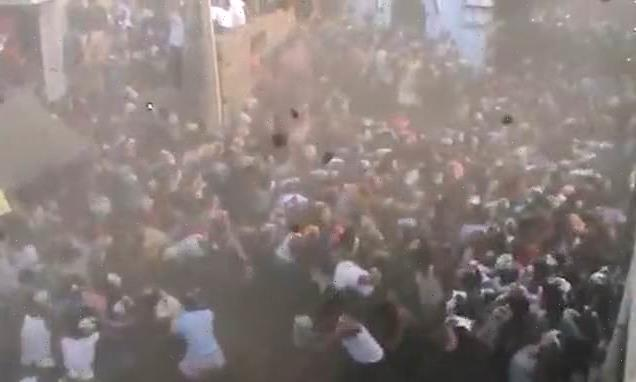 Thousands gather for dung-throwing festival in India as Covid soars