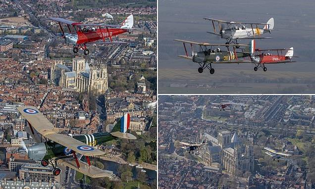 Tiger Moth squadron flies 'missing man' formation for Prince Philip