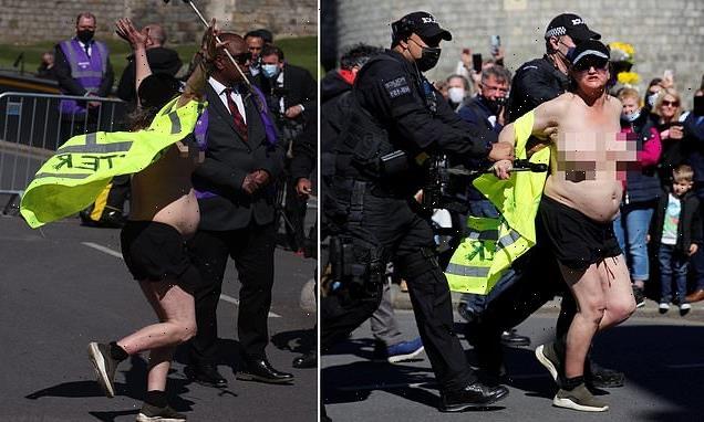 Topless woman sprints down Windsor High Street