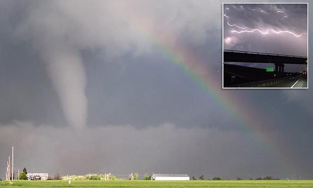 Tornado and rainbow appear side by side in stunning image