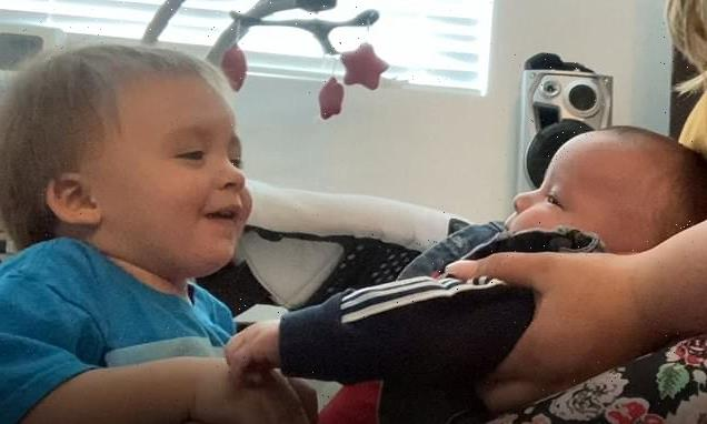 Utah boy, 1, won't let go of his four-month-old baby brother