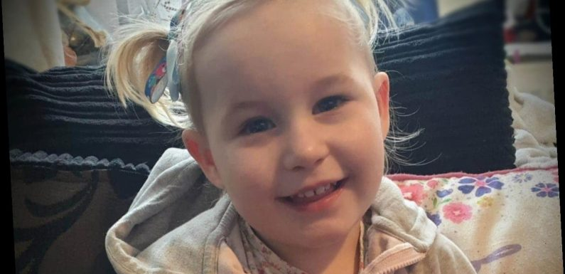 Girl, two, with 'beautiful smile' dies from head injury as cops arrest two people on suspicion of assault and neglect