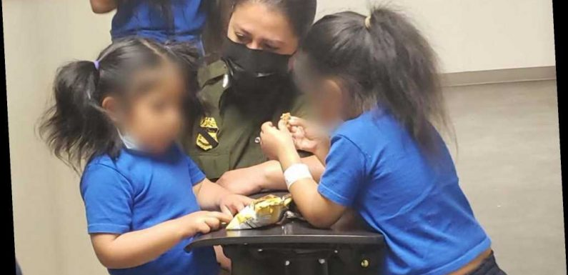 Photos show girls who were dropped over fence having snacks with border agent