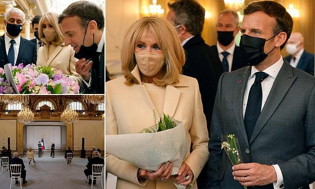 Emmanuel Macron and wife Brigette attend Lily of Valley ceremony