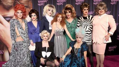 'Eyes of Tammy Faye' Star Jessica Chastain Joined by Gaggle of Drag Queens at NYC Premiere
