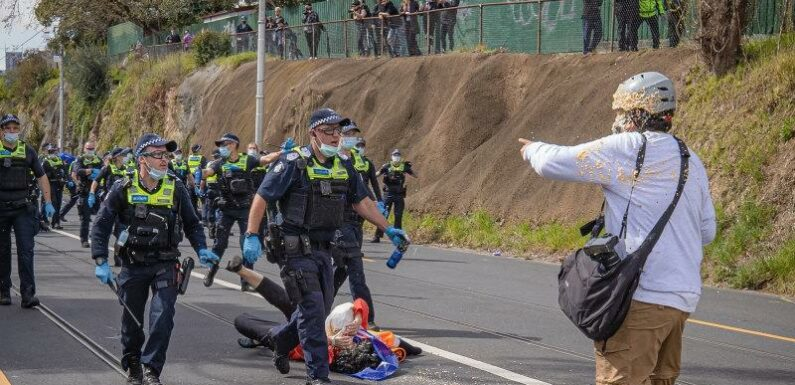 Age photographer capsicum sprayed by police during protest