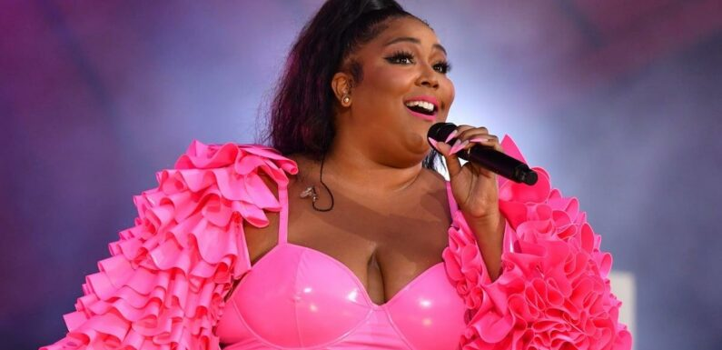 Lizzo Challenged Barbie to Top Her Hot Pink Lace-Up Catsuit, and It's Going to Be Tough